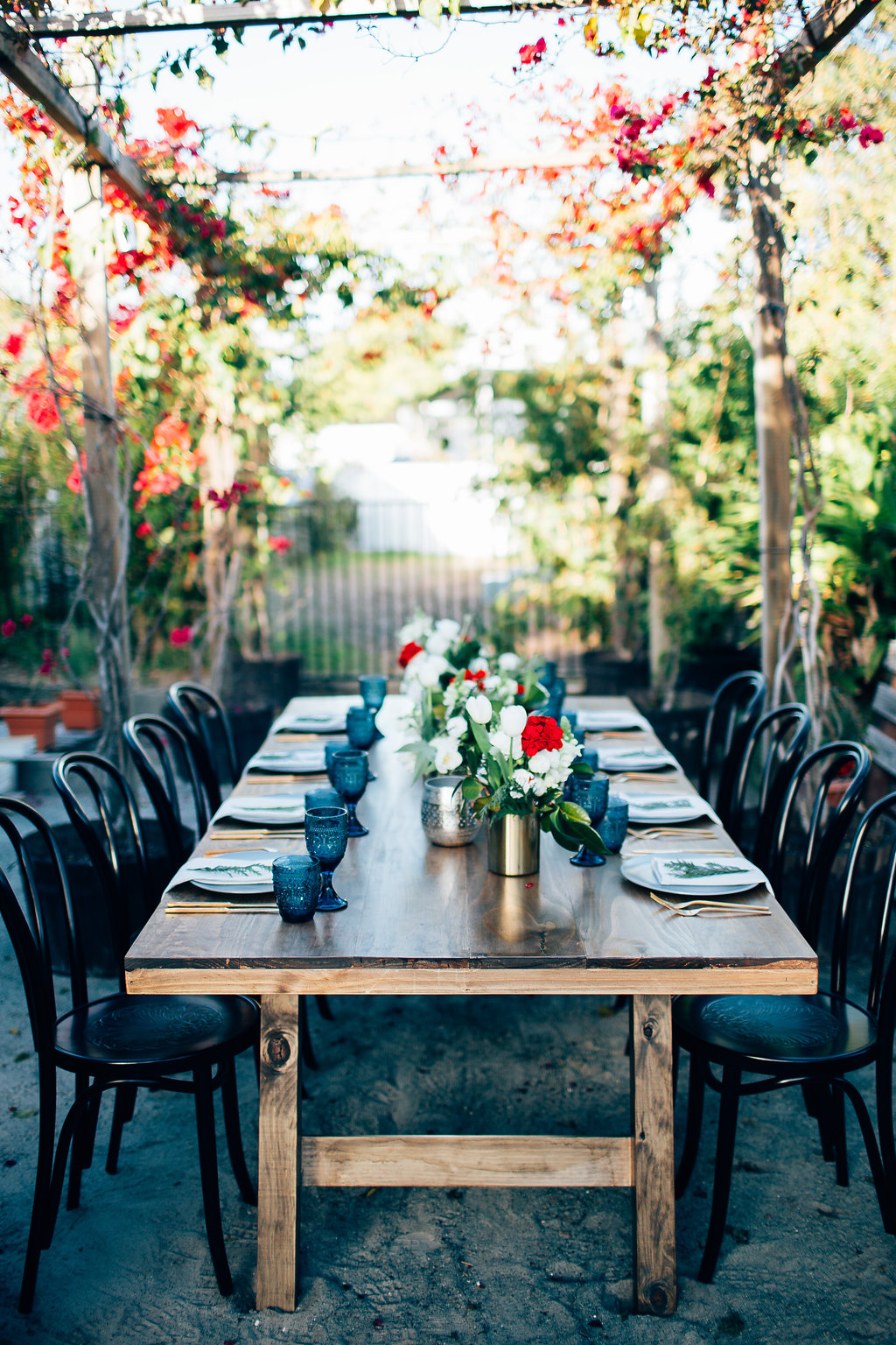 ostHampton Event Hire - Wedding and Event Hire | Christmas Table Styling Inspiration at Osteria Casuarina | Black Bentwood Chairs and Feasting Tables | www.hamptoneventhire.com | Photo by Figtree Pictures