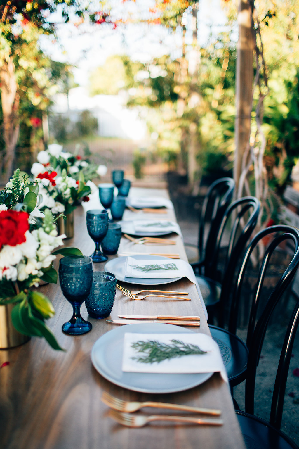 Hampton Event Hire - Wedding and Event Hire | Christmas Table Styling Inspiration at Osteria Casuarina | Blue Glassware | Gold Cutlery | www.hamptoneventhire.com | Photo by Figtree Pictures