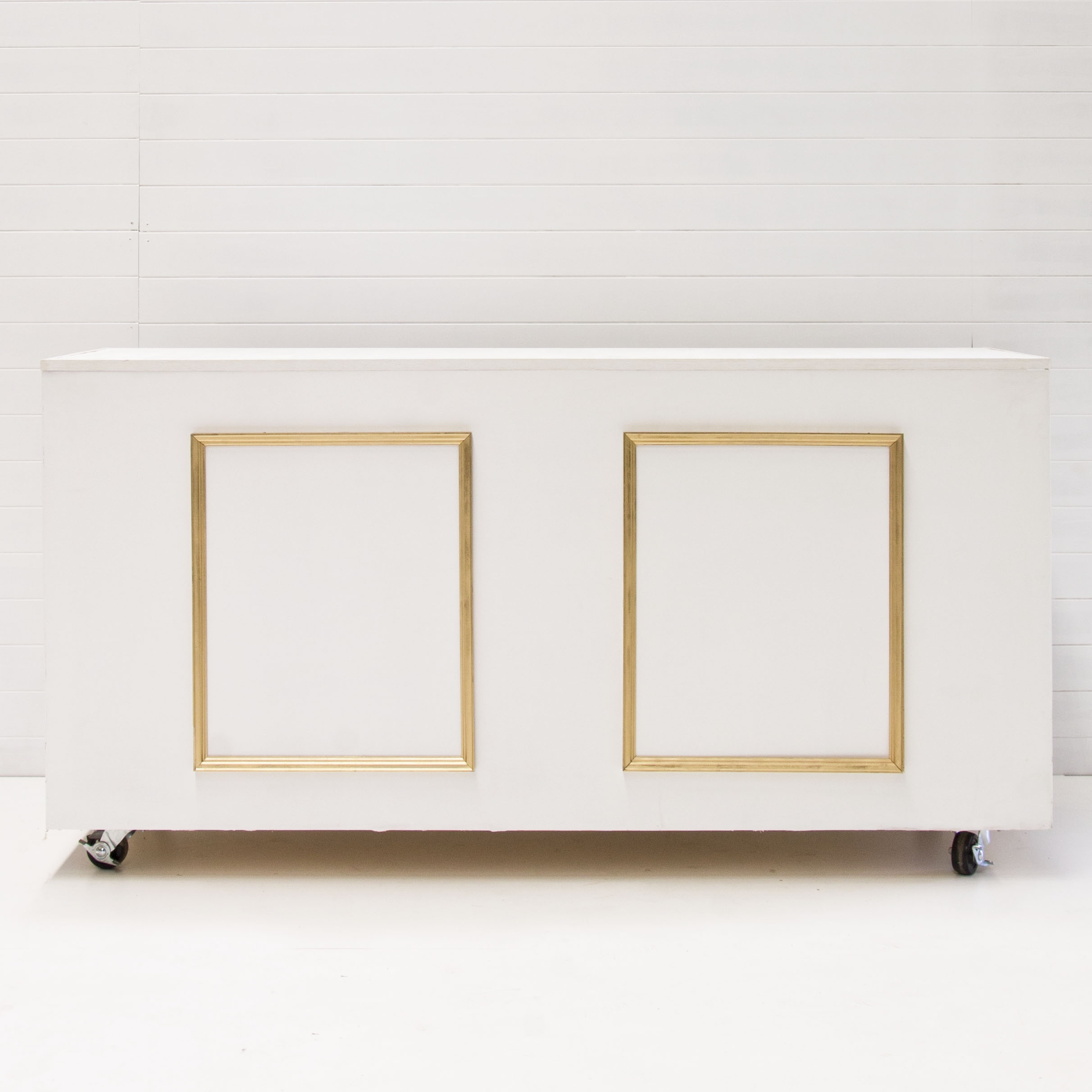 WHITE AND GOLD REGAL BAR
