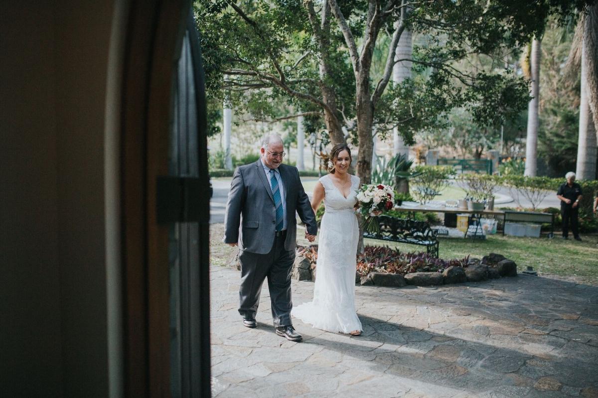 Melissa and Adam Coolibah Downs Wedding | Hampton Event Hire | Photo by White Fox Studios | bride entrance