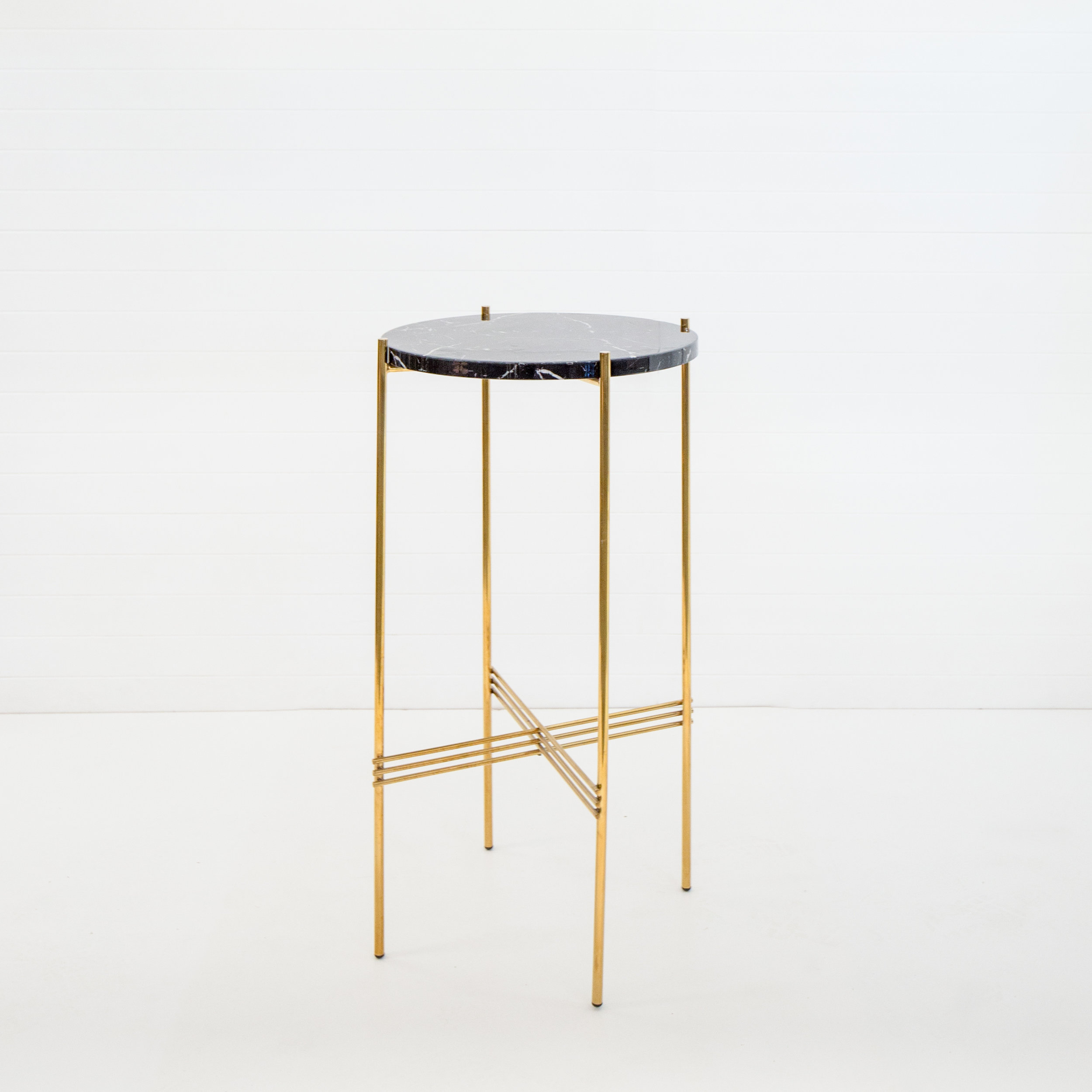 Round gold Icelandic dry bar with black marble