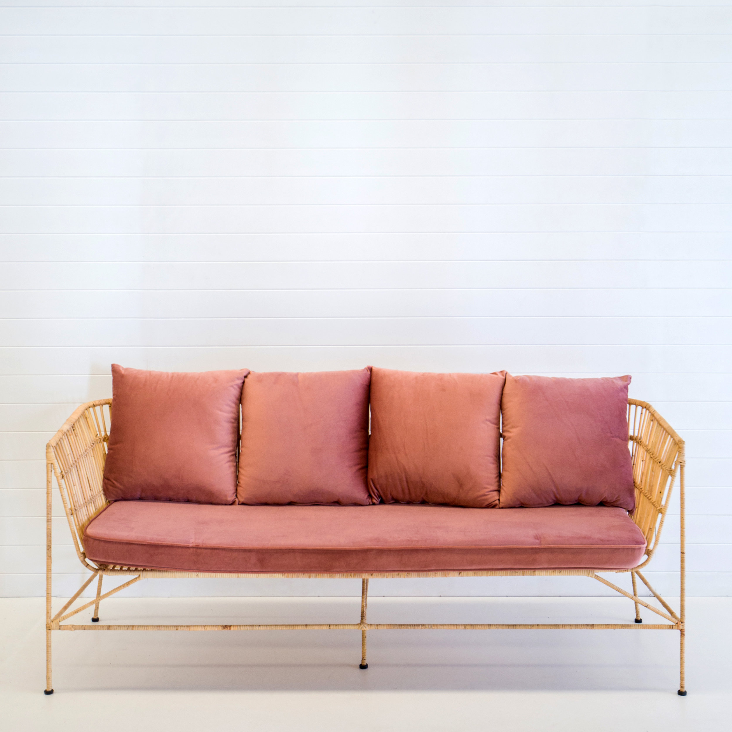 Indie natural sofa with dusty pink cushions