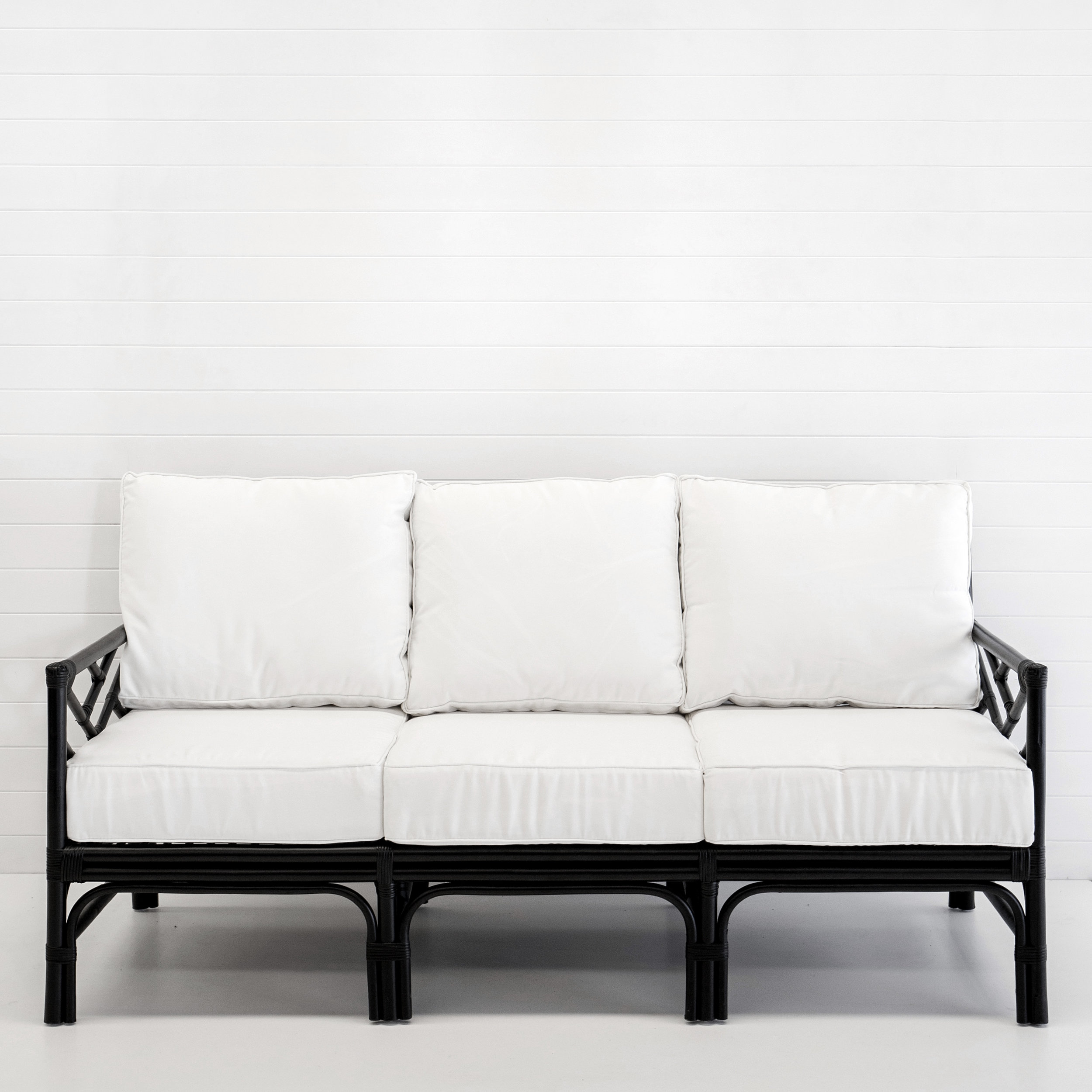 Hamptons black 3-seater sofa with white cushions