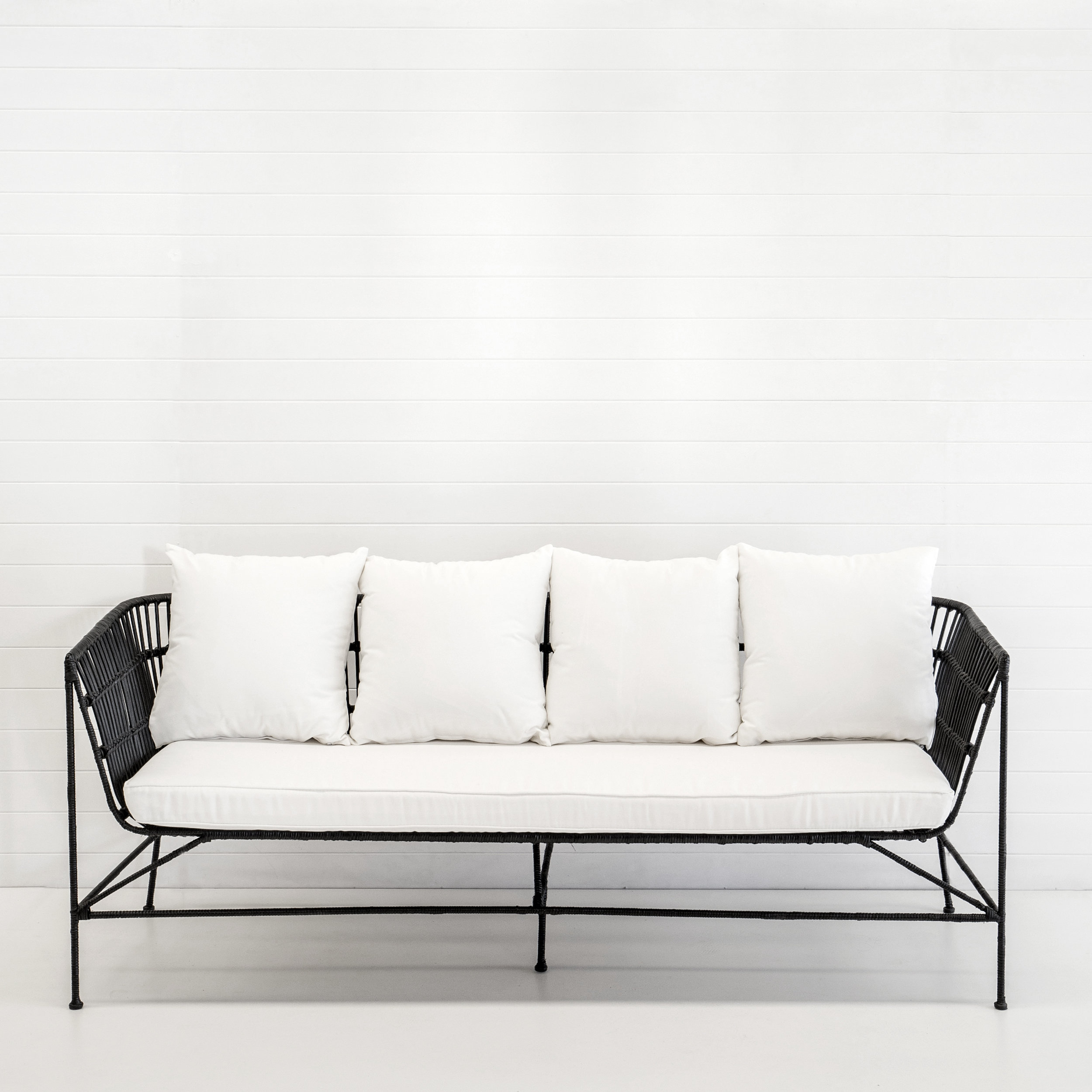 INDIE BLACK 3-SEATER SOFA WITH WHITE CUSHIONS
