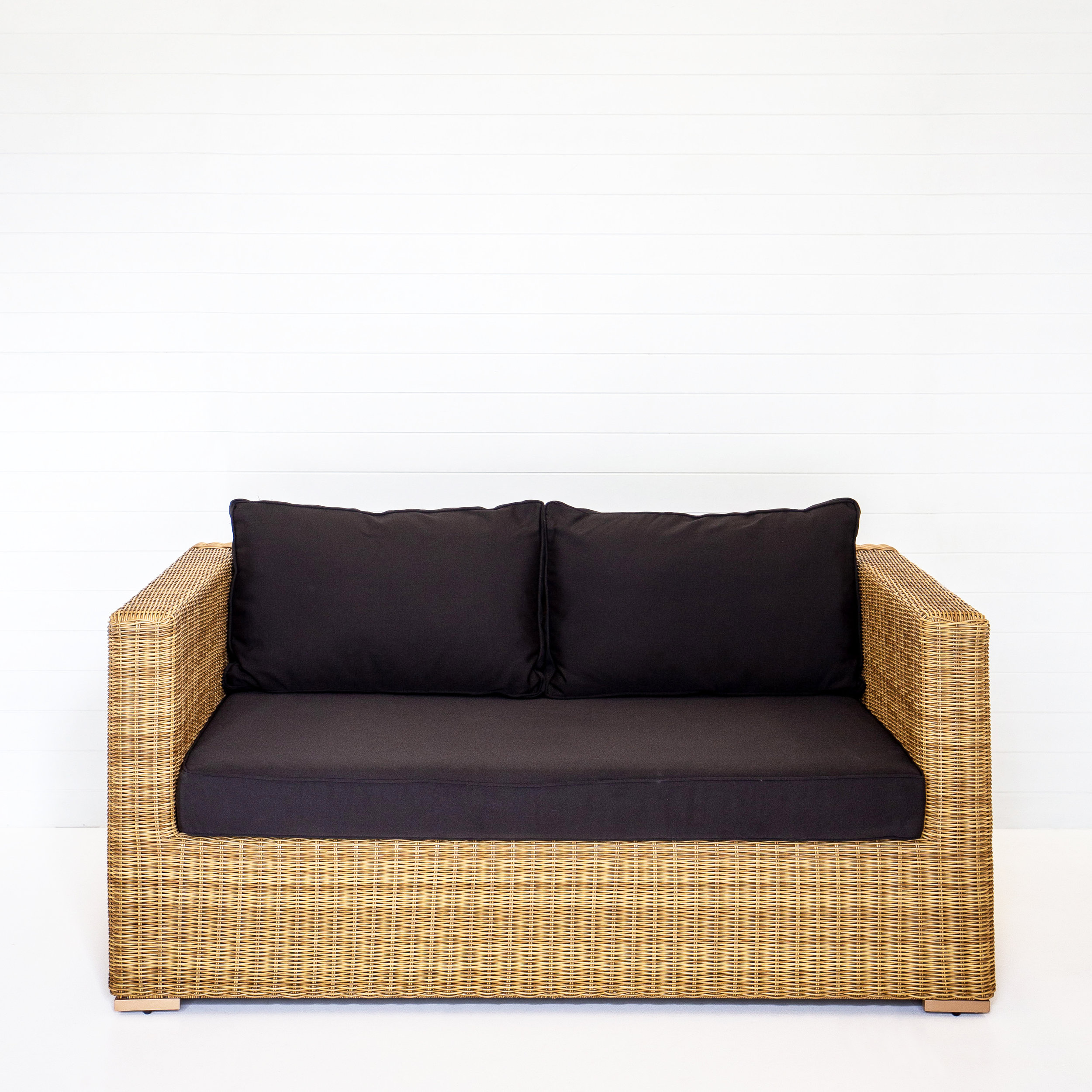 DUNE TWO SEATER SOFA (WITH ARMS) WITH BLACK CUSHIONS