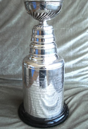 Restoration - A miniature version of the real Stanley cup would be a treasure for any hockey fan, even one that isn't a former member of the Boston Bruins. In this case, our local sports hero's treasure had years of wear and tear that had left their replica trophy dingy, dented and less than a spectacular representation of their achievement.Morgan Jewelers was able to not only bring the original sheen and polish back to the appearance of the cup, but also delicately remove a dent that had been a blemish on this fine piece of workmanship. Today, the cup has the same newness in appearance that it had when first created, and it showcases not only the achievement of it's owner, but the pride of what this symbol represents.