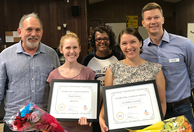 Megan Stewart and Liz Holder-Crawford recognized on their five-year service anniversary. - Executive Director Larry Elsner, East School Site Director Sheila Matthews, and Board Chair Tony Clark presented the Open Door Board of Directors Certificate of Appreciation to teachers Megan Stewart (L) and Liz Holder-Crawford (R). In addition to their exemplary work as teachers, Megan and Liz are also Open Door parents, and Liz has previously served as Assistant Site Director at the East school. CONGRATULATIONS MEGAN AND LIZ!