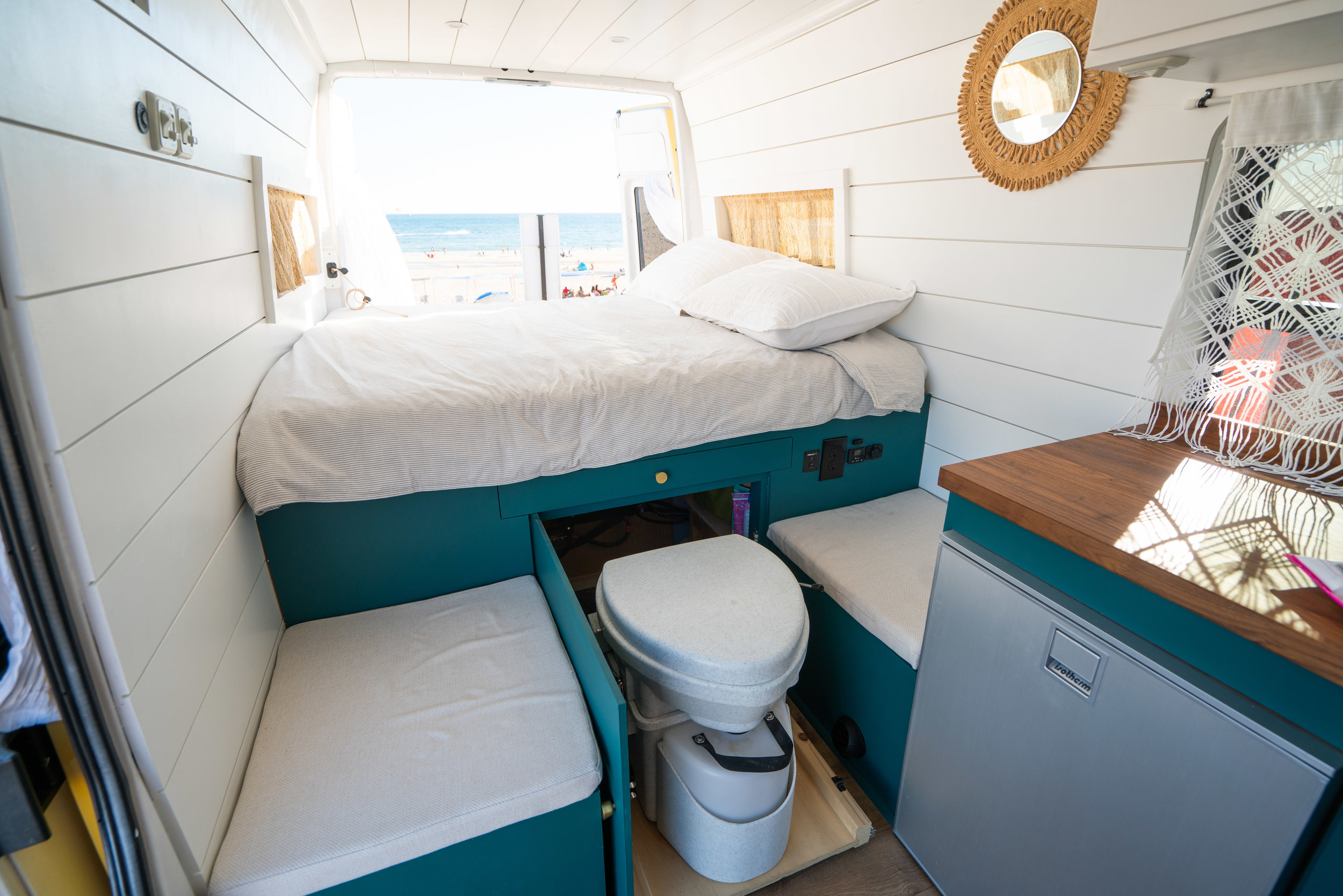 Our toilet is on slide out platform with a 500lb drawer slide beneath the bed