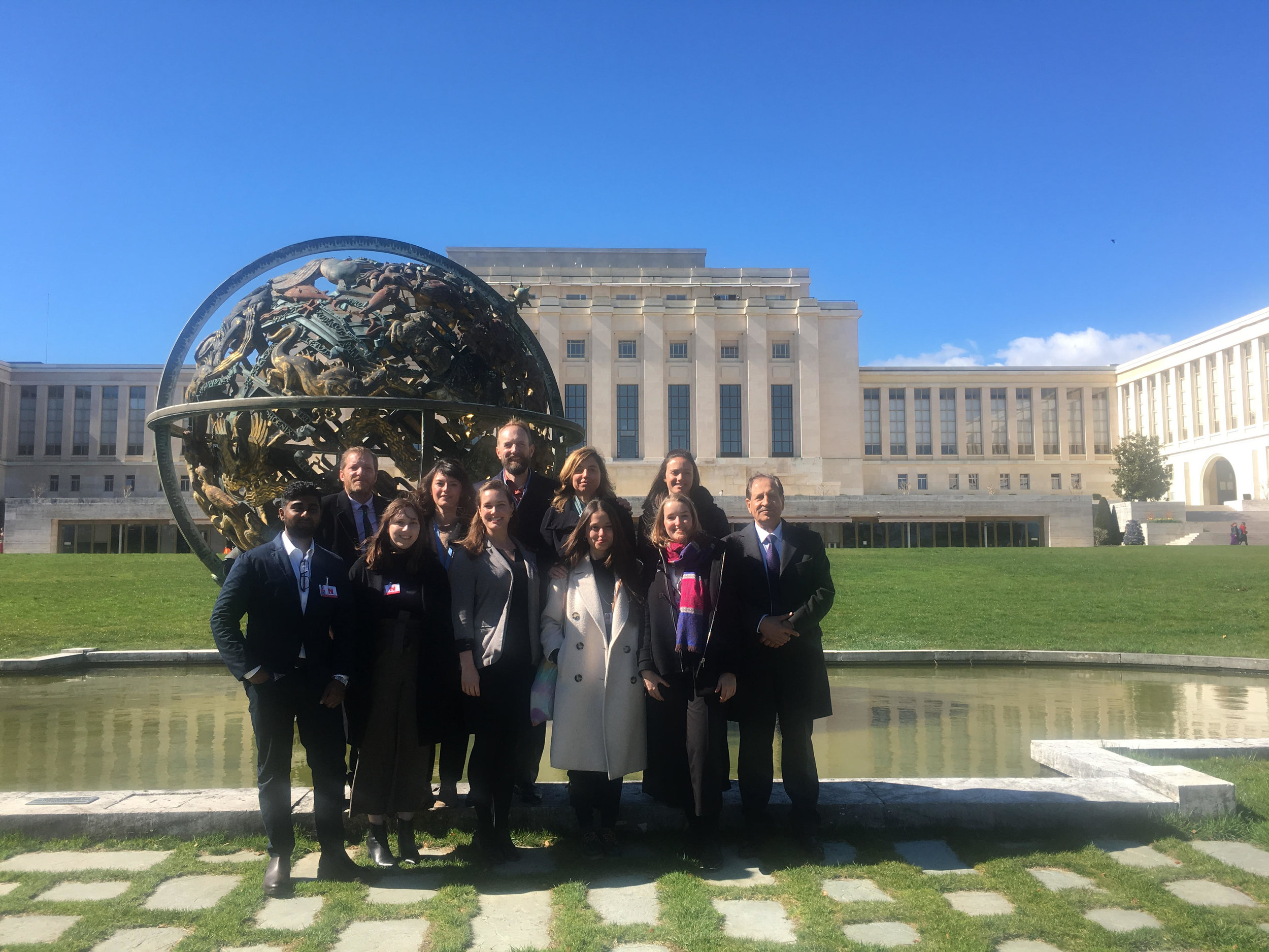 Previous participants in front of the Palais des Nations at the 40th Session of the Human Rights Council.