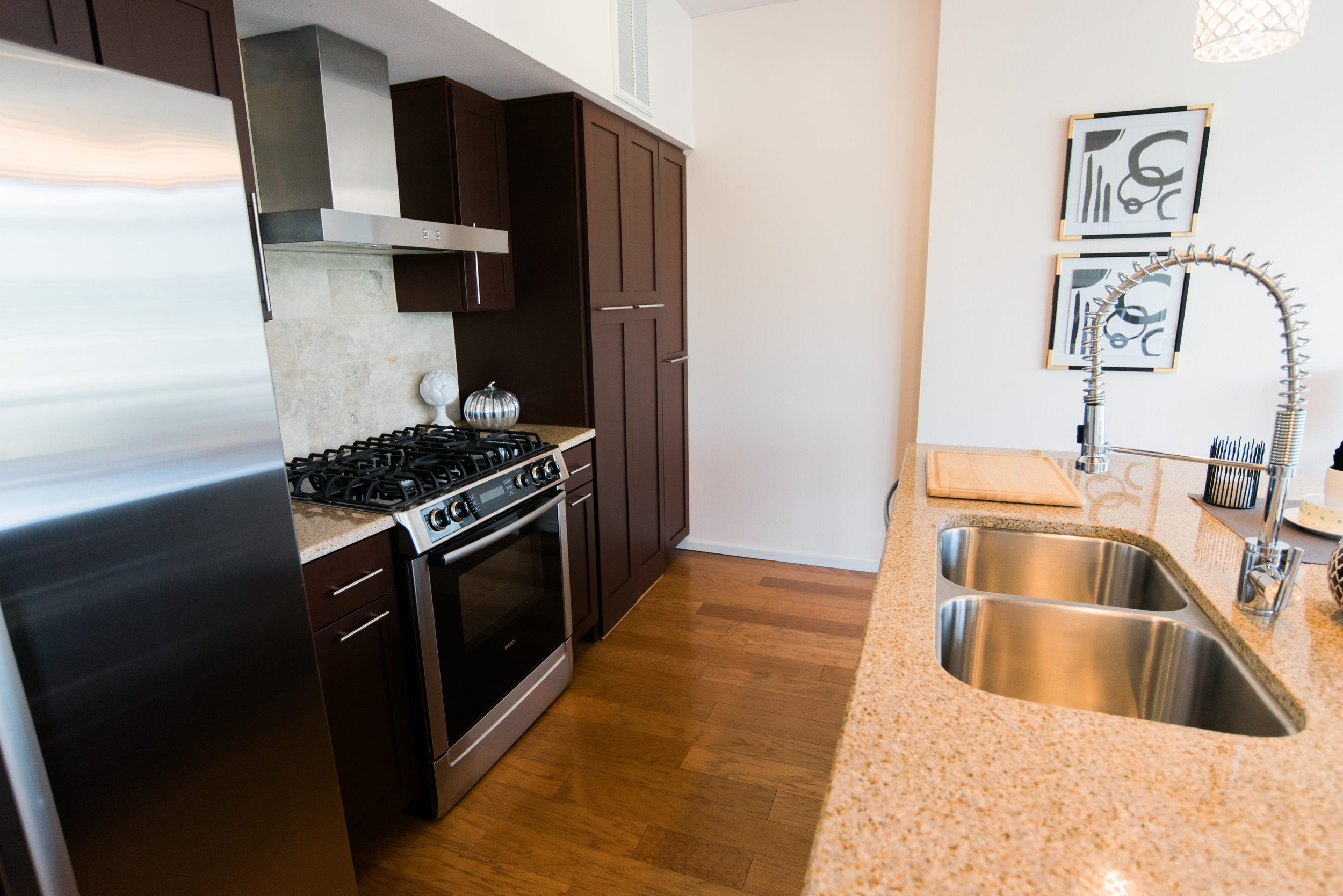 Updated kitchen with gas stove and stainless steel appliances.