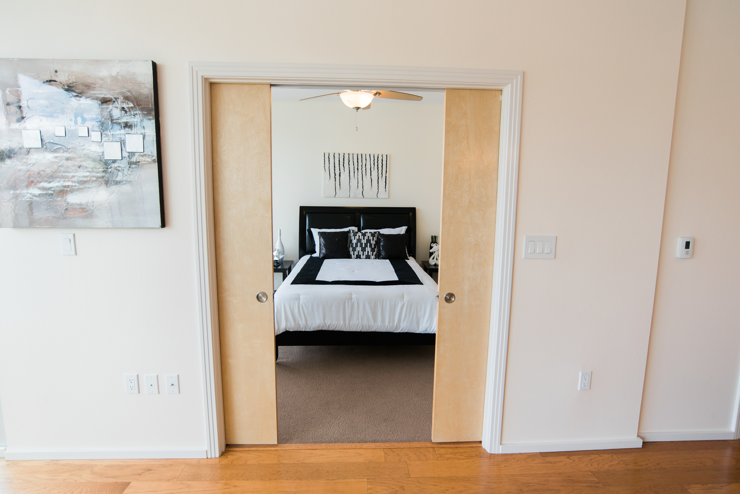 Pocket doors leading to private bedroom