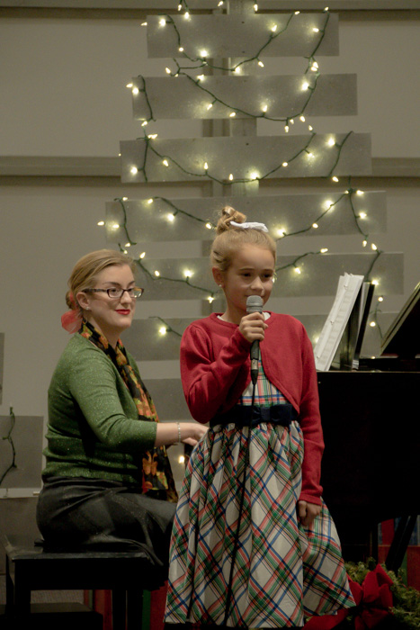 Victoria plays for her vocal student in December Recital