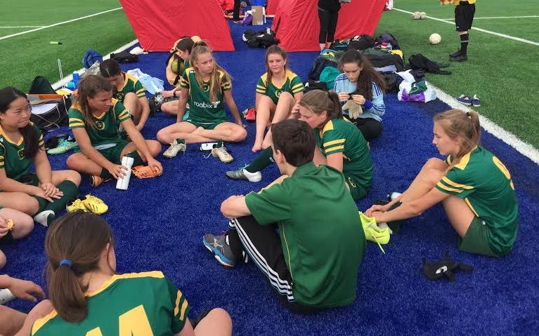 The 17's Girls having their post game talk with coach Matthew Stewart