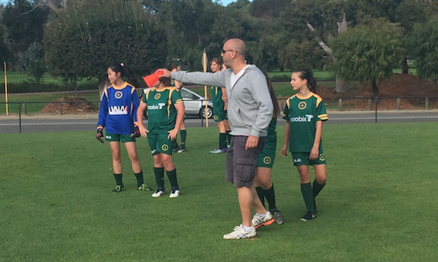 14 girls coach Chris Mallios instructs his team