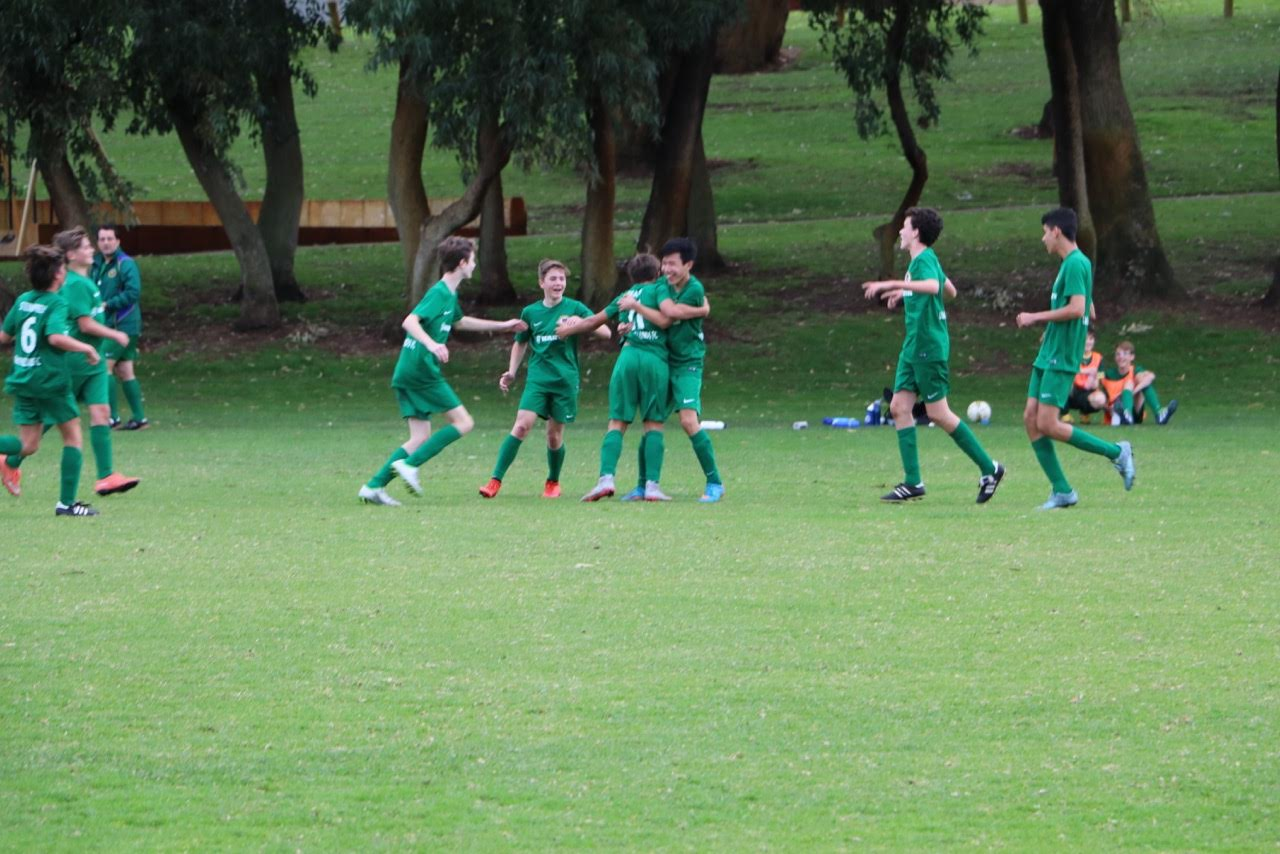 The 14 boys celebrate their winner against Wembley Downs