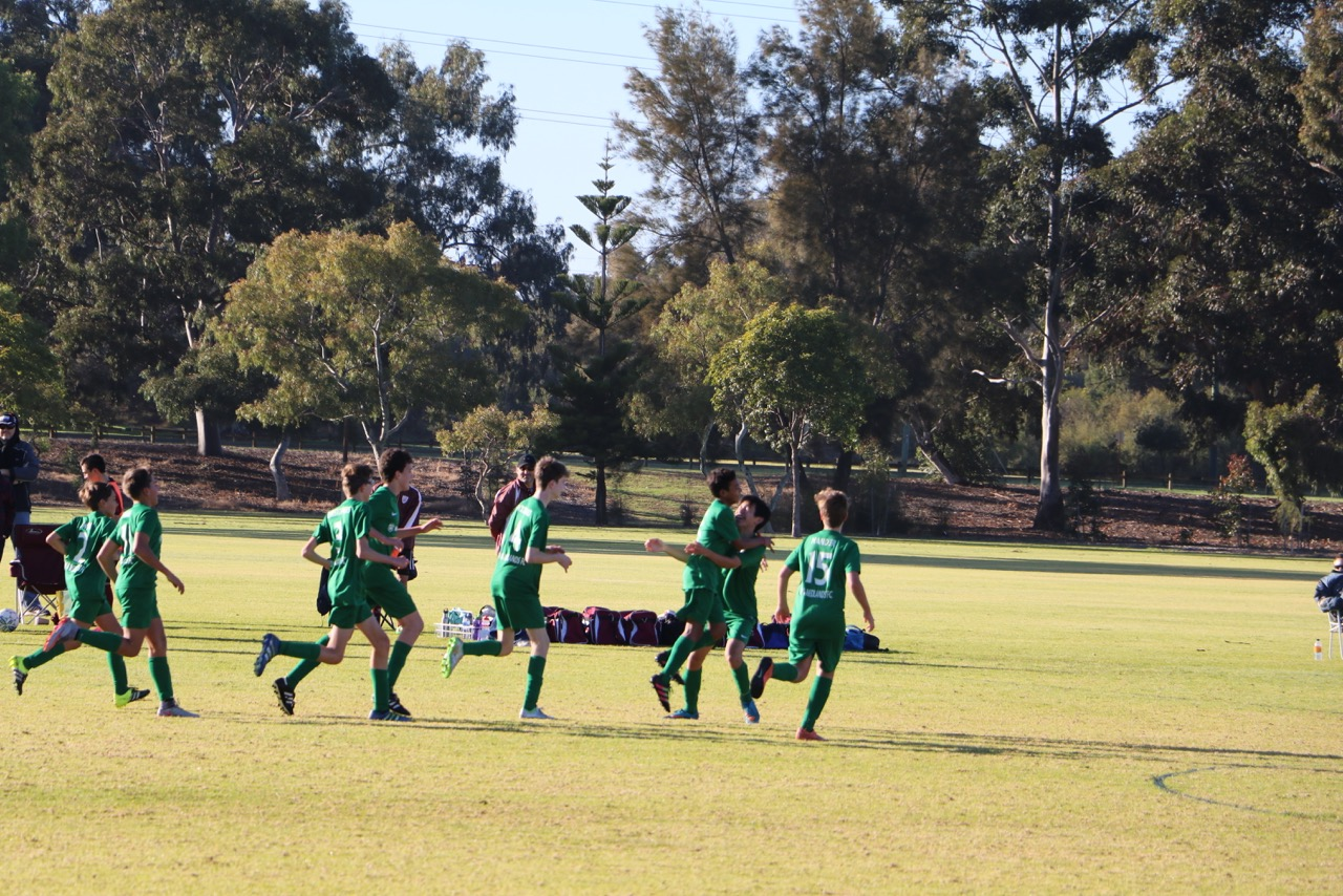 The 14 Boys celebrate Meng's goal against Dianella SC
