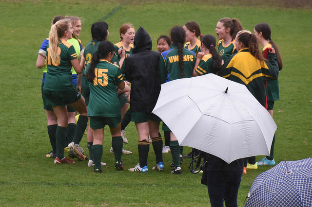 The U17 Girls huddle up at half time - Photo Courtesy of Bill Hallager