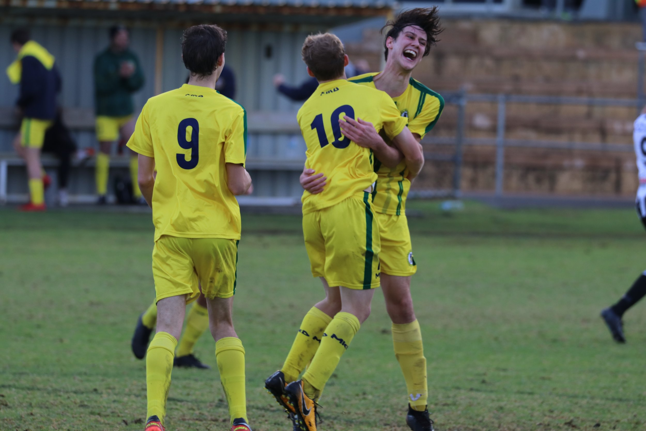 Kretowicz and Taylor celebrate the second goal of the day - Credit: Gabriele Maluga