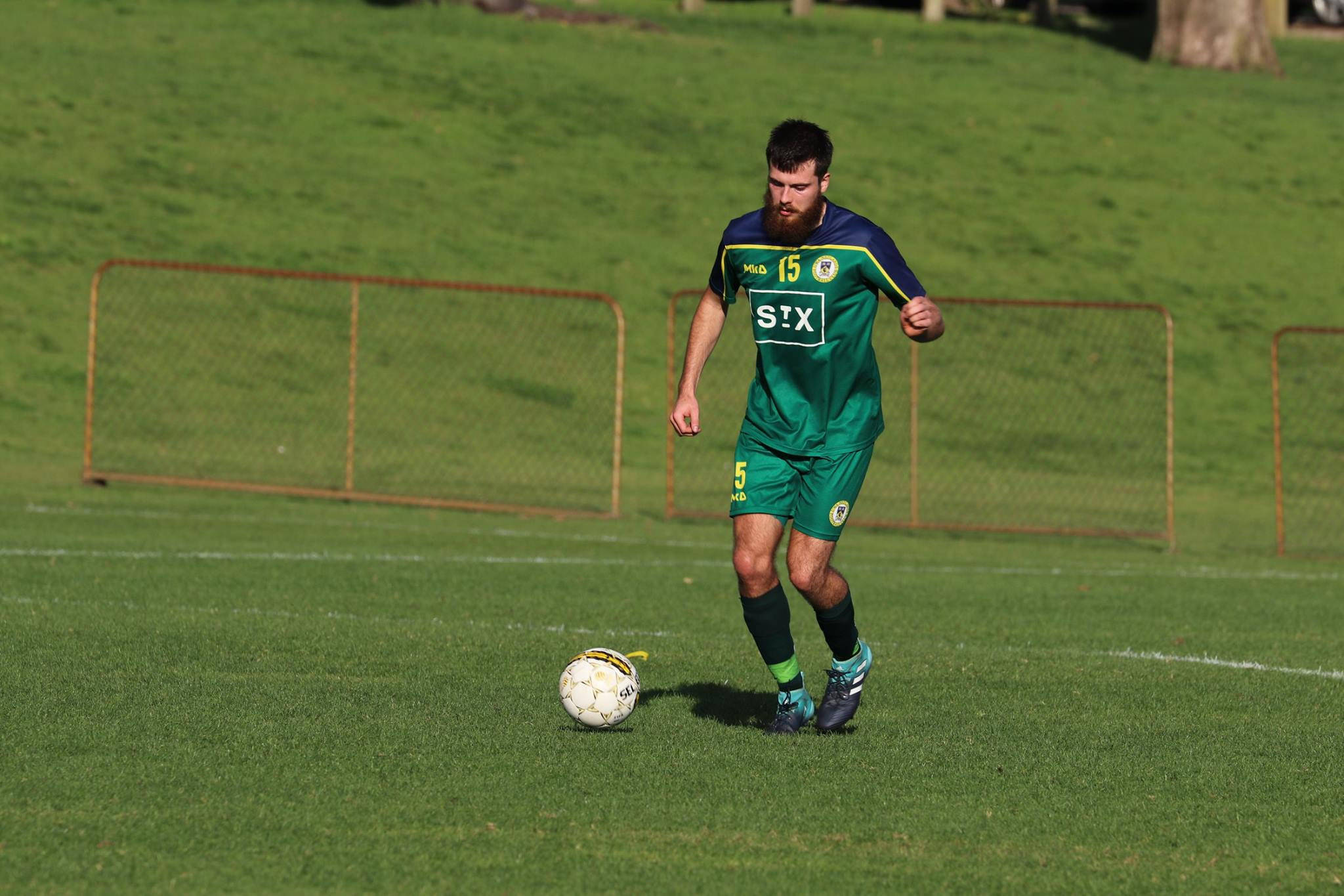 TOM MORONEY ON THE BALL AGAINST MORLEY - CREDIT: GABRIELE MALUGA