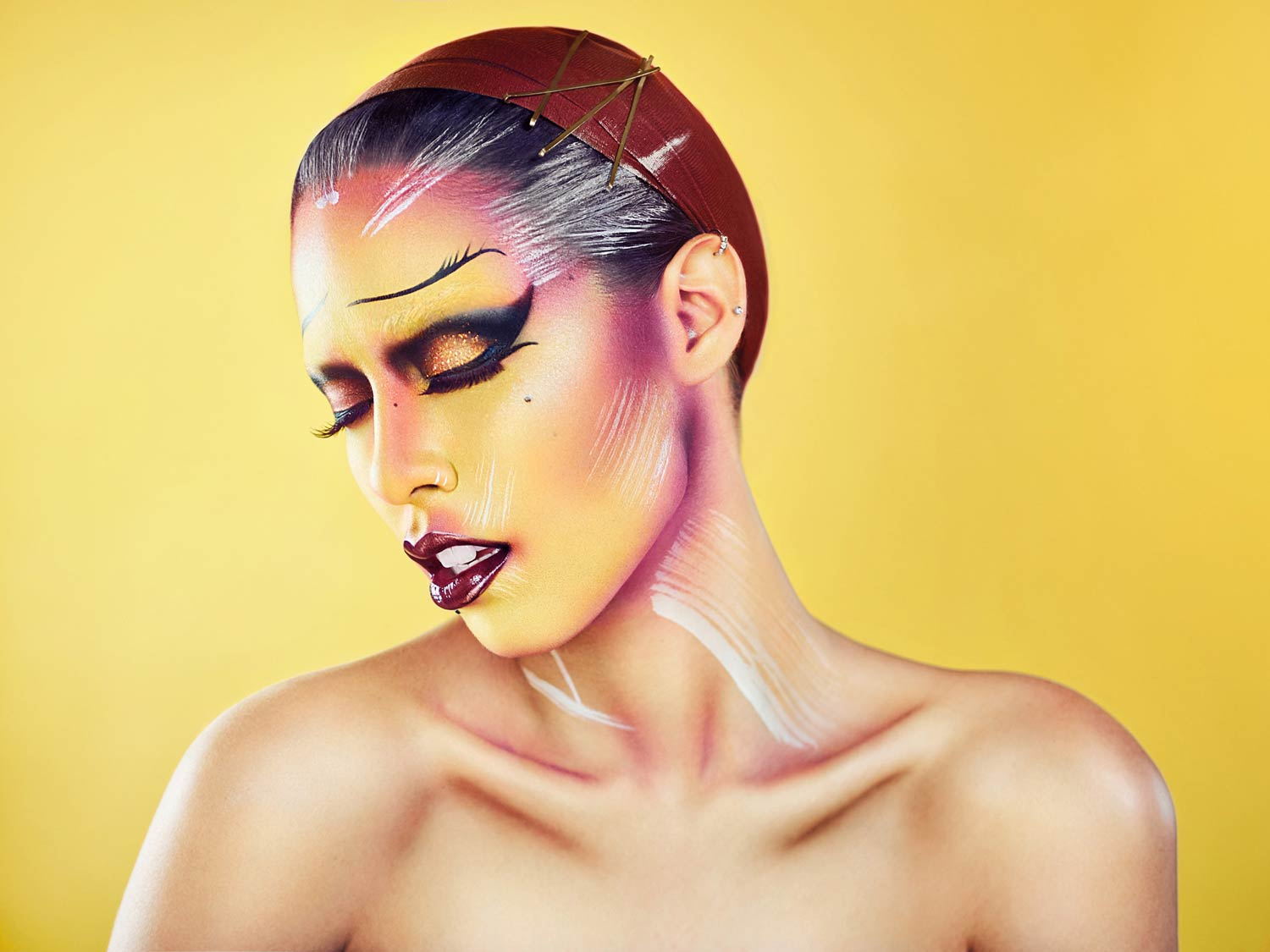 High fashion editorial image of a model in Avant Garde makeup taken by Samgold Photography in Orlando FL
