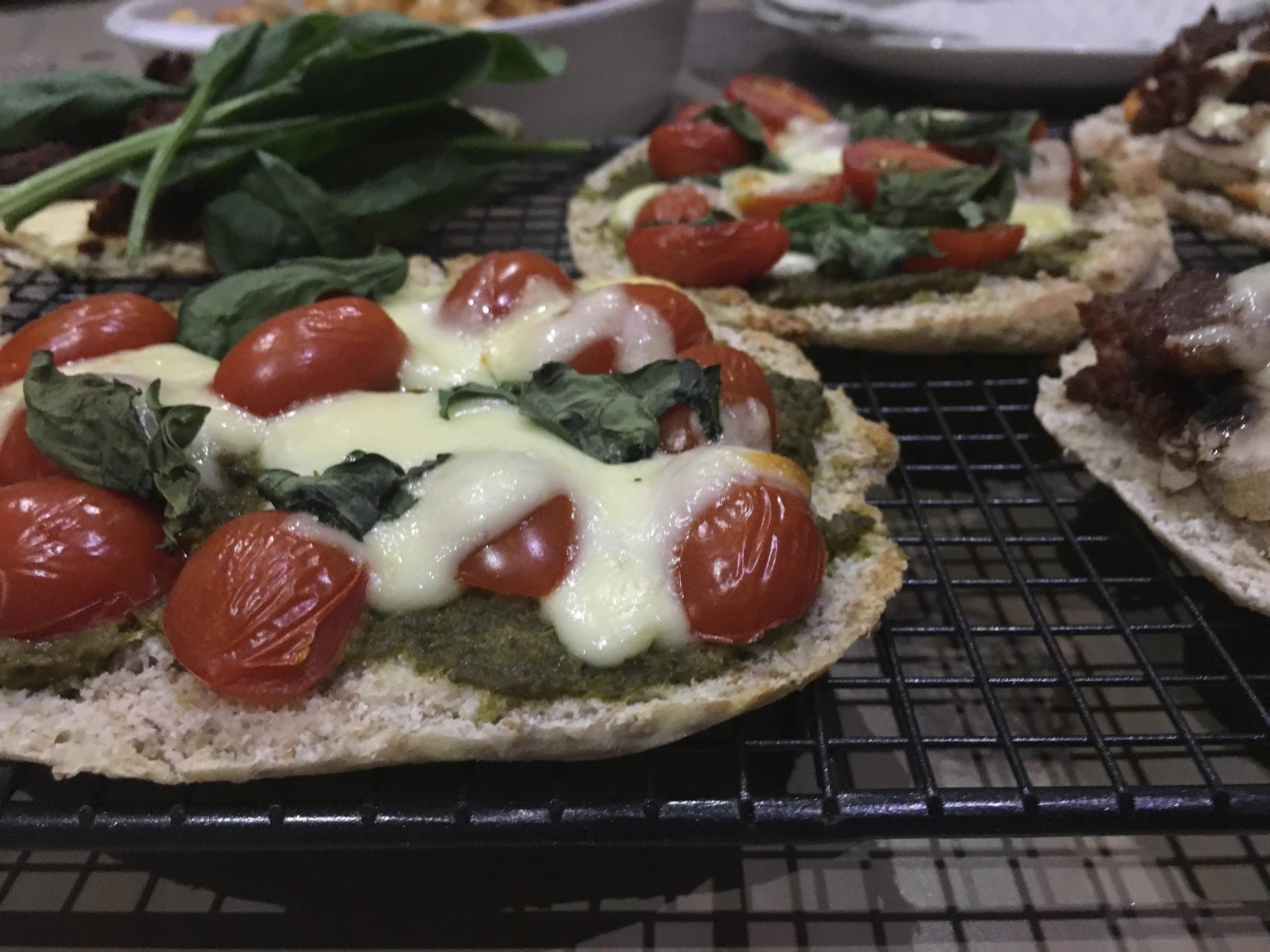 Caprese pita pizza with mozzarella, basil pesto and rosa tomatoes