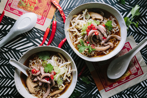 Slivers of lamb on a bed of noodles in a fragrant lamb broth.