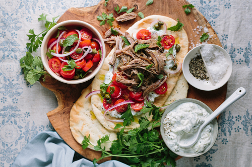 Juicy tender pulled lamb on freshly toasted pitas with double cream tzatziki and tomato salad.