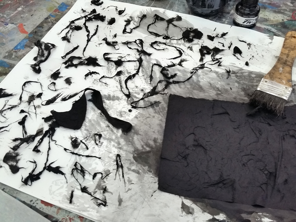 Japanese silk paper covered with acrylic in and gently rubbed to produce fragile fibres