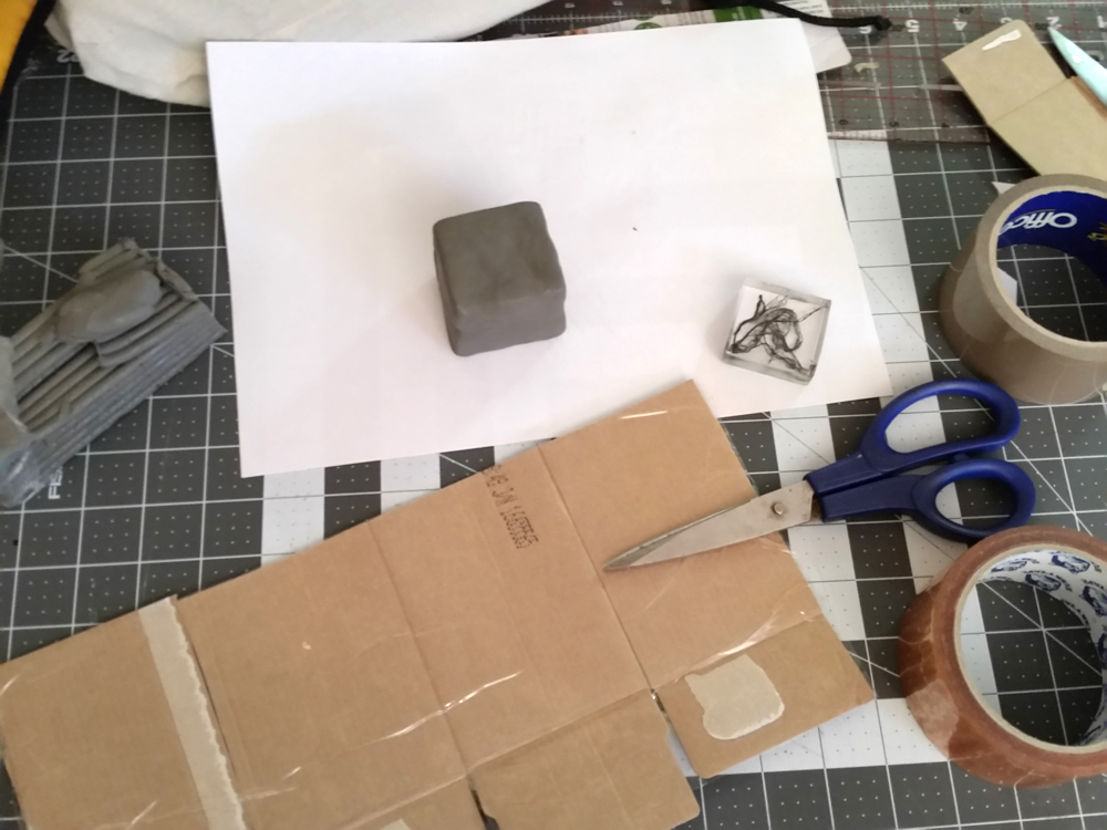Created square block with modelling clay and created a box to surround the block for mould making