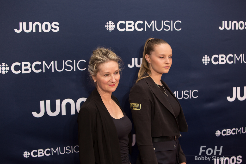 Charlotte Day Wilson, right, on the 2019 JUNO Awards red carpet at Budweiser Gardens, in London, Ontario, CANADA