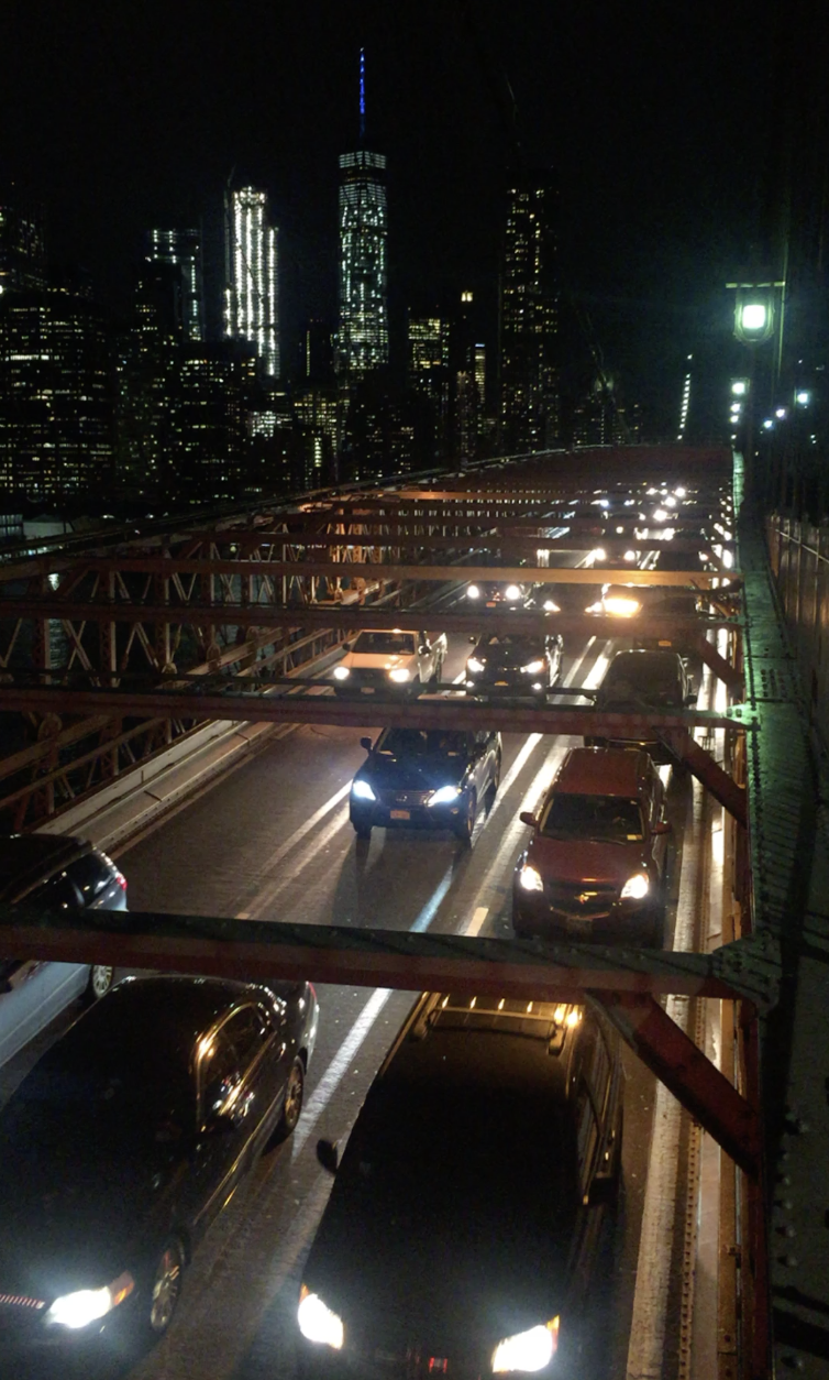 Traffic on the Brooklyn Bridge - This system of mysterious,Interconnected madness,As consciousness becomes optional--Requisite with a temper,Fighting unfathomable expectationsThat fight to keep us in line,Peaking over shoulders to getA better view of the middle,Where, in darkness,Hands folded and head fallen,Before a mindless slumber takes hold,Before our memories fade,If they were ever even really made,The course corrects;The system breaks;And we find our way homeTo the only thing that matters.