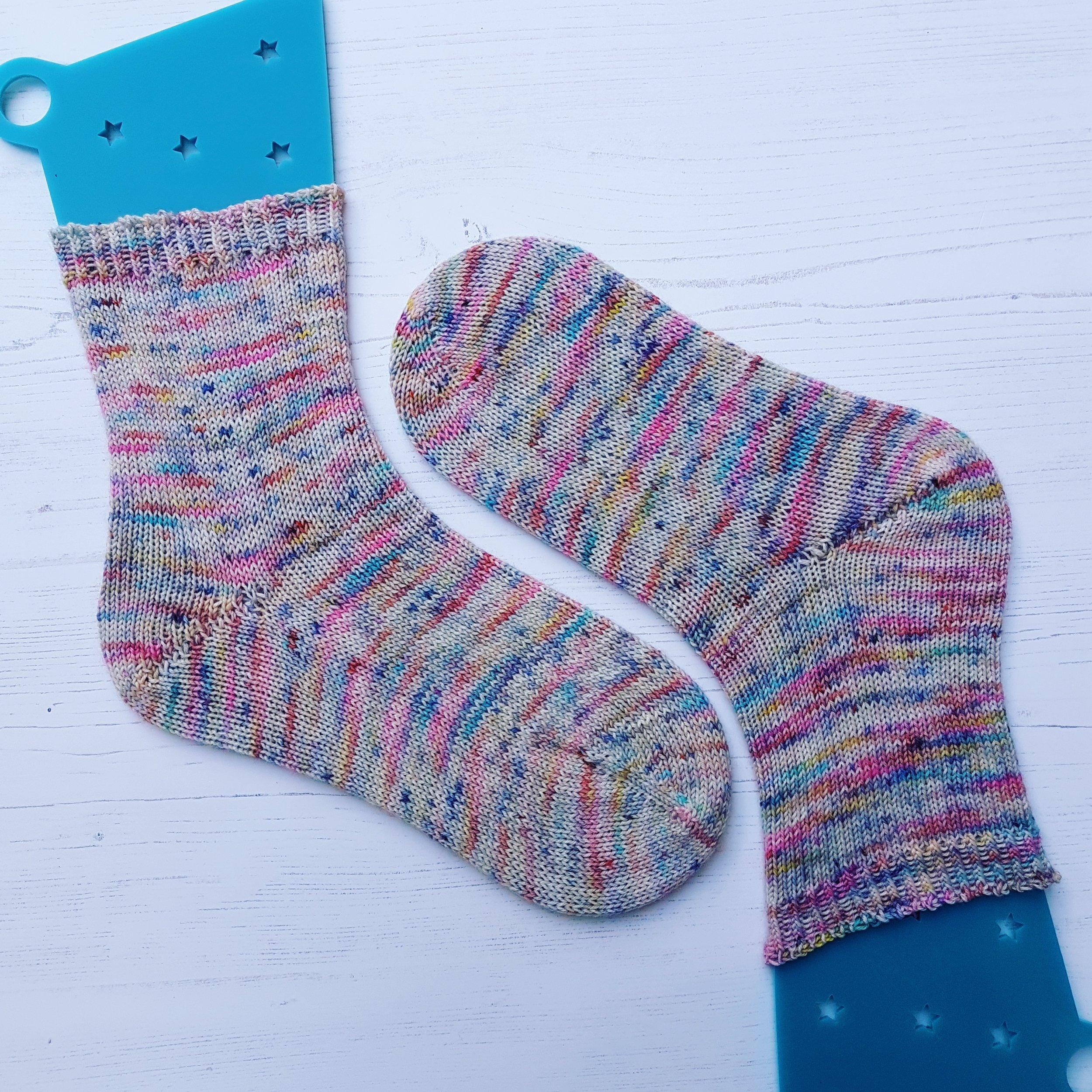 Toe-up socks in yarn from West Green Loft Yarns
