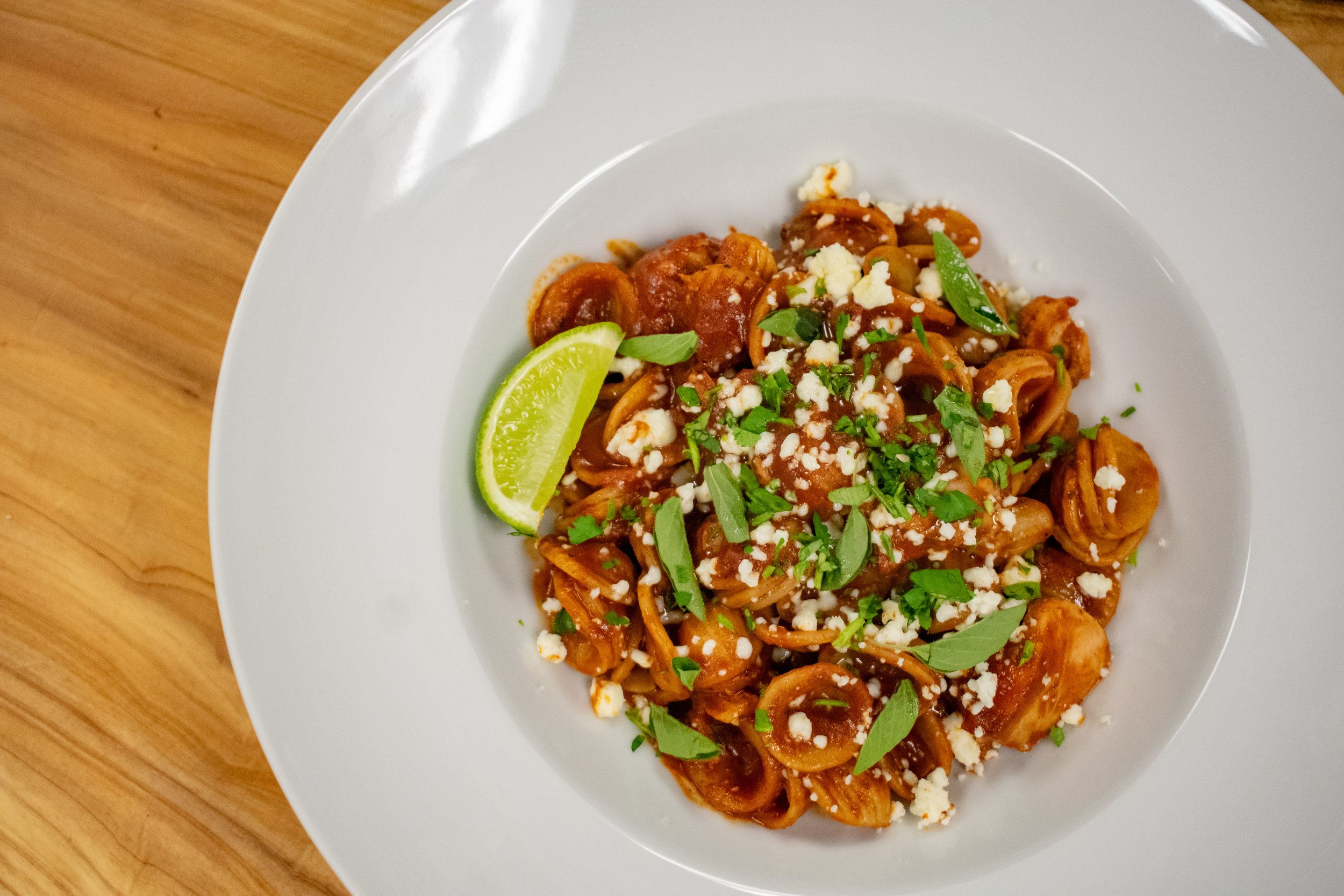 Pulled Chicken Mole Orecchiette with Cojia Cheese & Fresh Lime