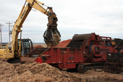 Reduce waste, create usable material - Clearing and grinding trees and fallen brush on a job site.
