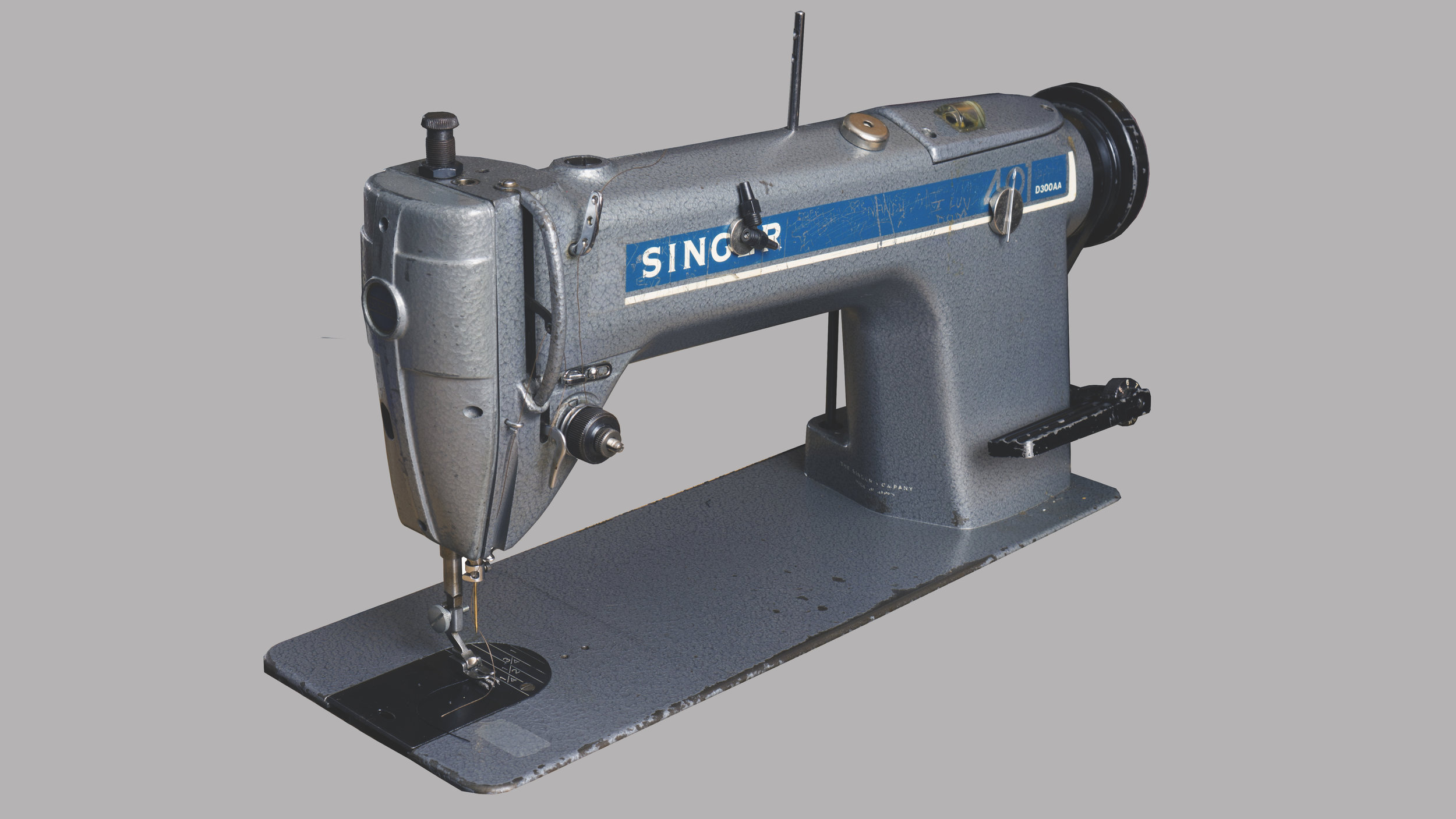 OL' TRUSTY - We picked up two of these Singer 495's from a tech school retiring it's older machines back when we first started. This guys' an excellent straight-stitch machine we work a lot of our light-medium duty pieces through.