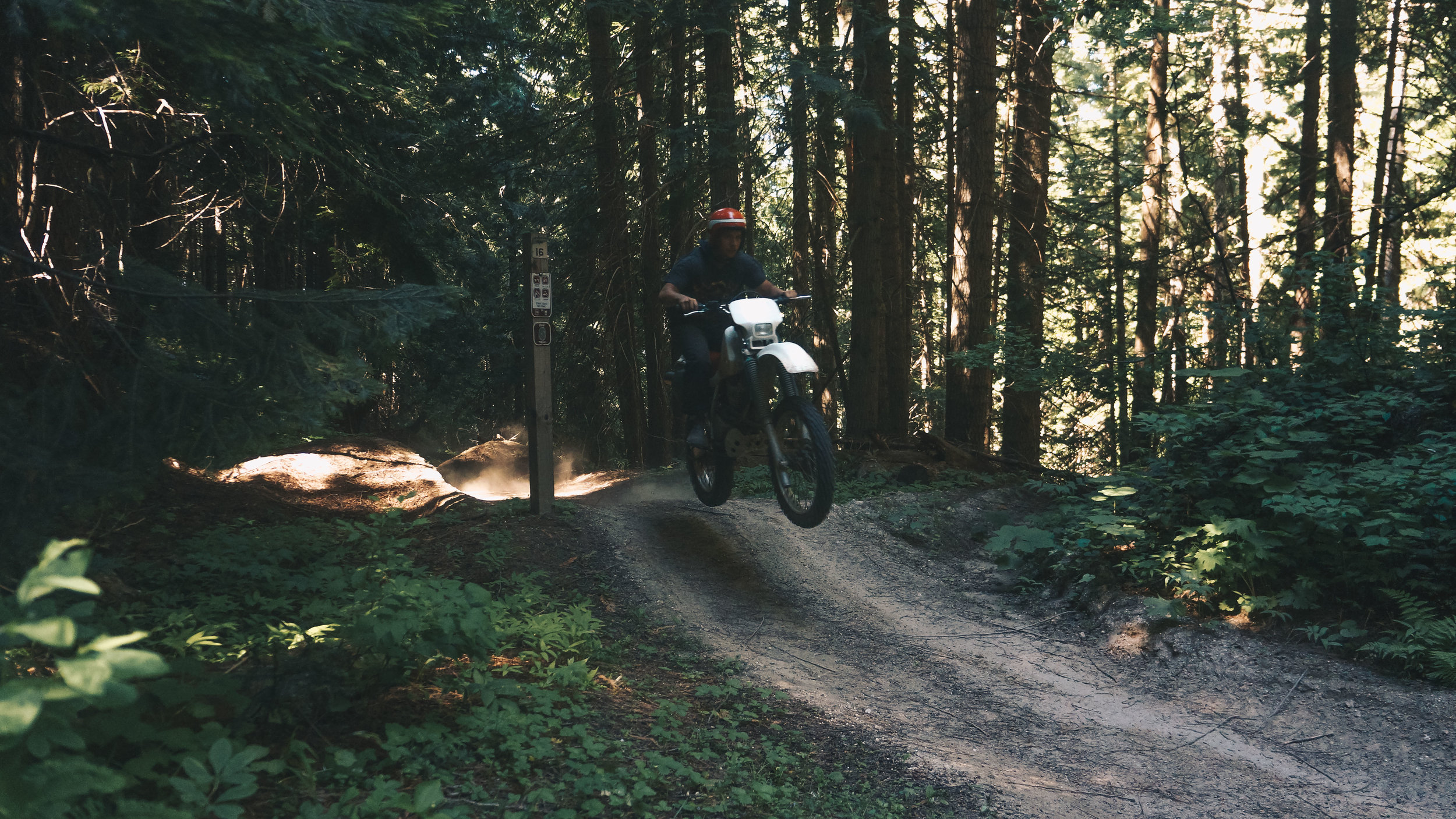 """Jump to exploring some of the fire roads in Clearwater N.F., ID. Taylor trying to """"send-it"""" over this lump of dirt"""