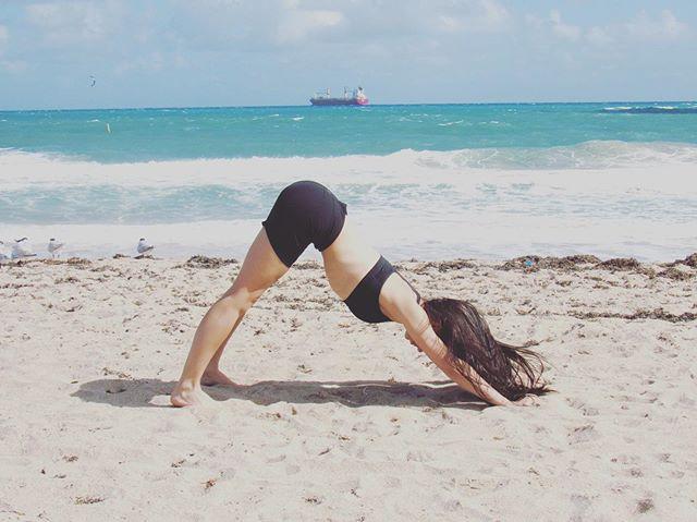 Riding with the tide 🌊 . . . . . #yoga #downwarddog #beachyoga #yogaeverywhere #yogaeveryday #yogainspiration #corporatewellness #corporateyoga #yogainstructor #messyhairdontcare