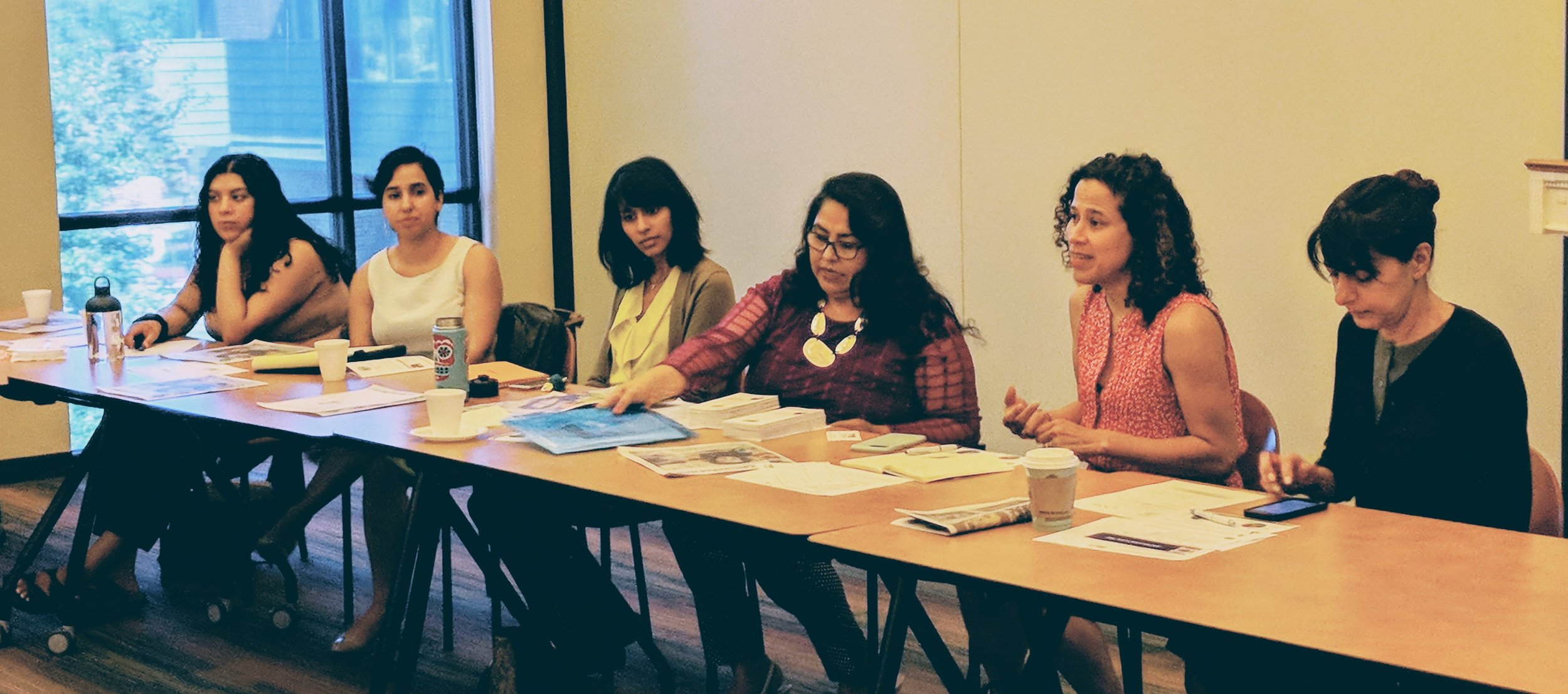 Leaders of the immigrant consortium addressing LaSup attendees, July 18
