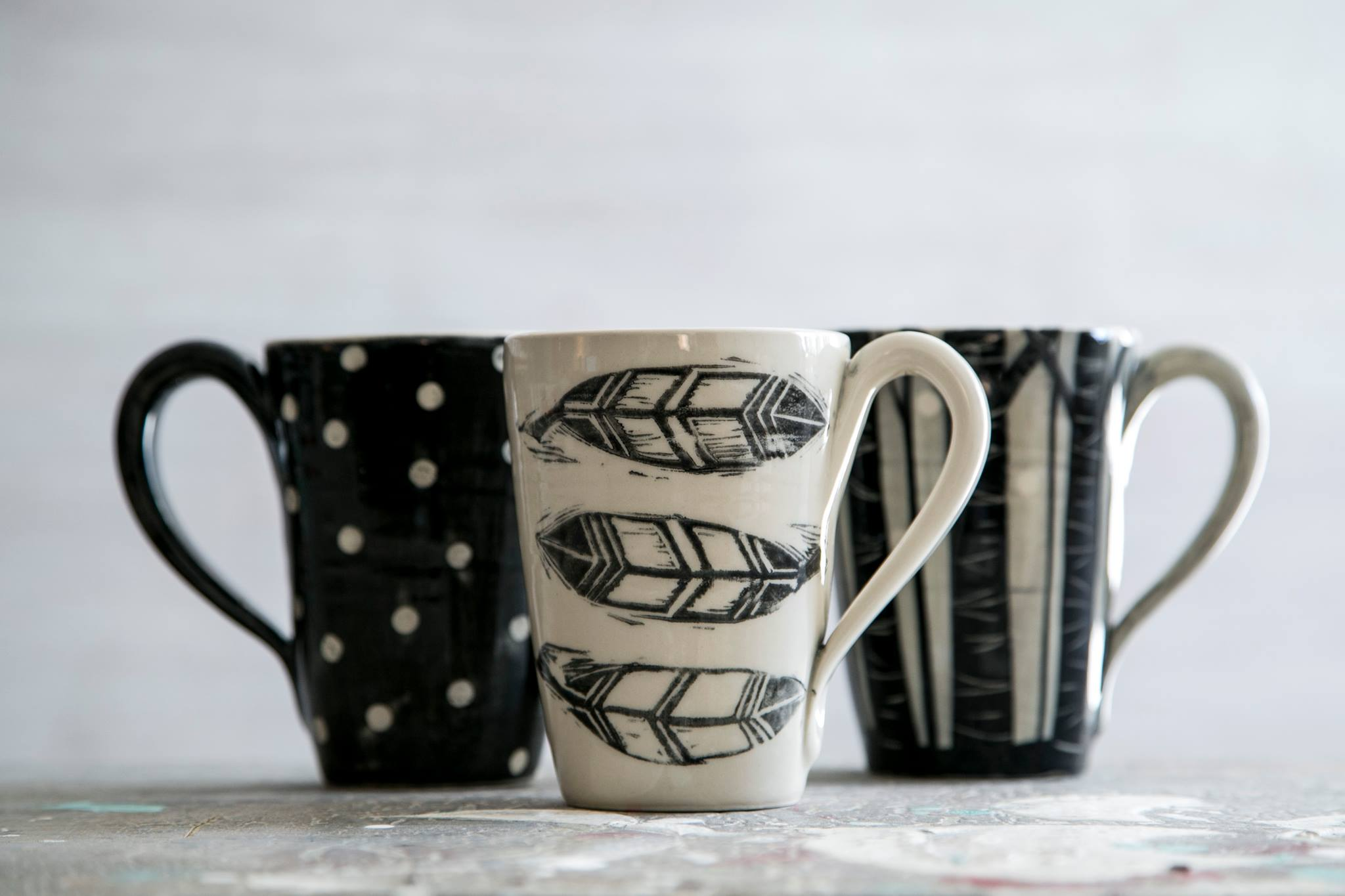 April Gates - Mugs with feathers.jpg