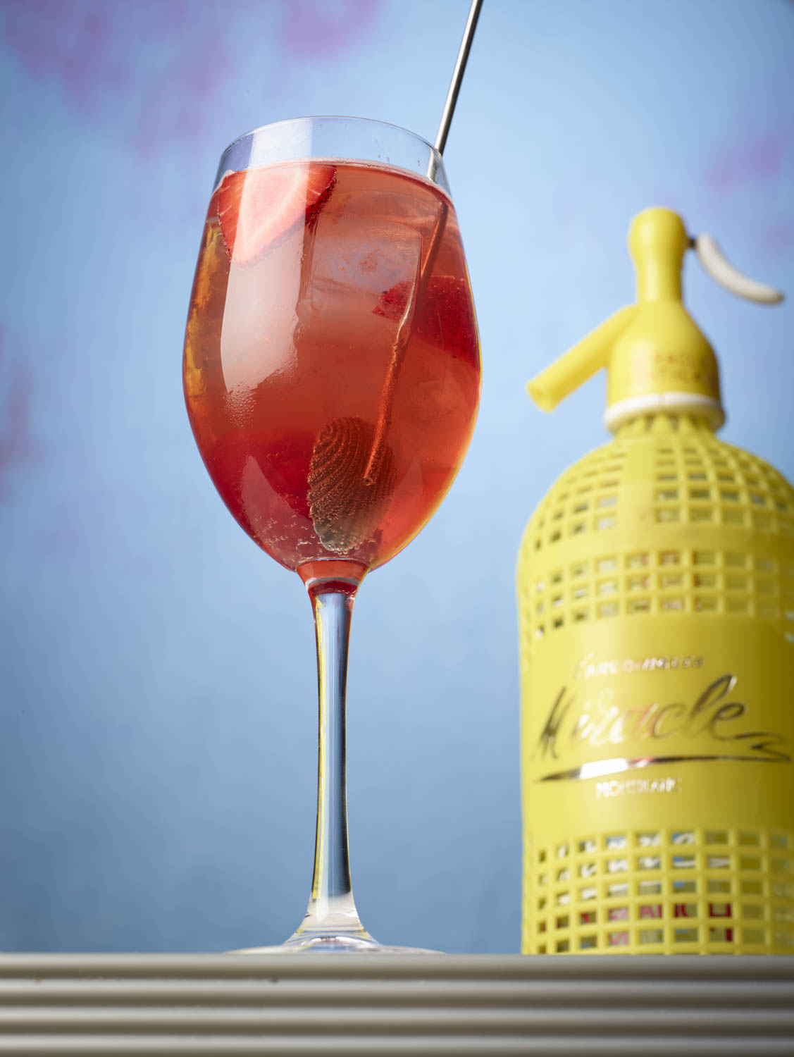 DC Spritz - 1.5oz Capitoline Tiber over ice in a wine glassProseccoClub sodaGarnihs with a slice of orange.