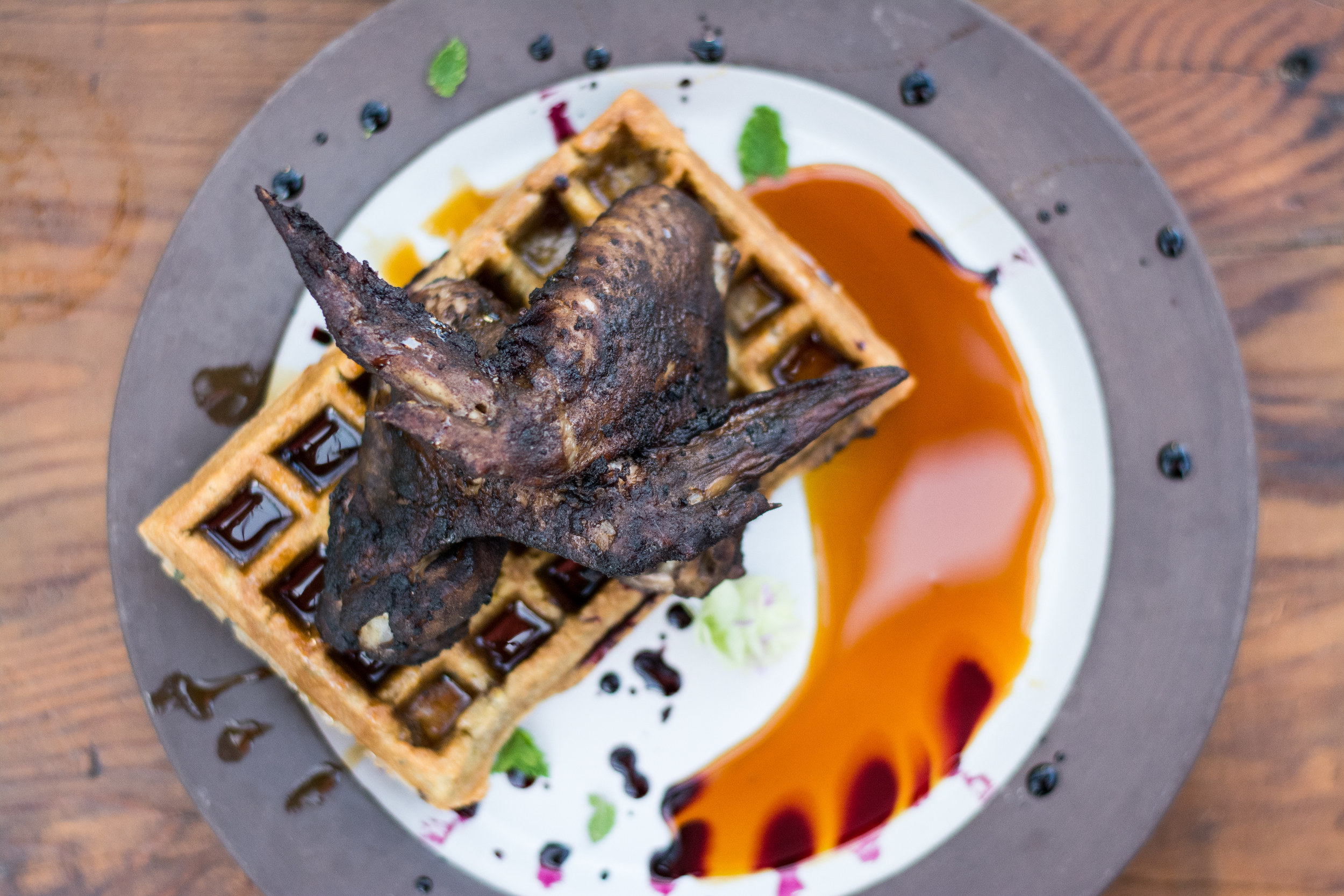 CHICKEN + WAFFLES    Chicken Wings, Herbs, Cassava Flour, Arrowroot, Butter, Chicken Bone Broth, Lemon, Egg, Coconut Sugar, Baking Soda, Salt) blueberry reduction, maguey sap, coconut syrup, coconut butter, olive oil, cinnamon