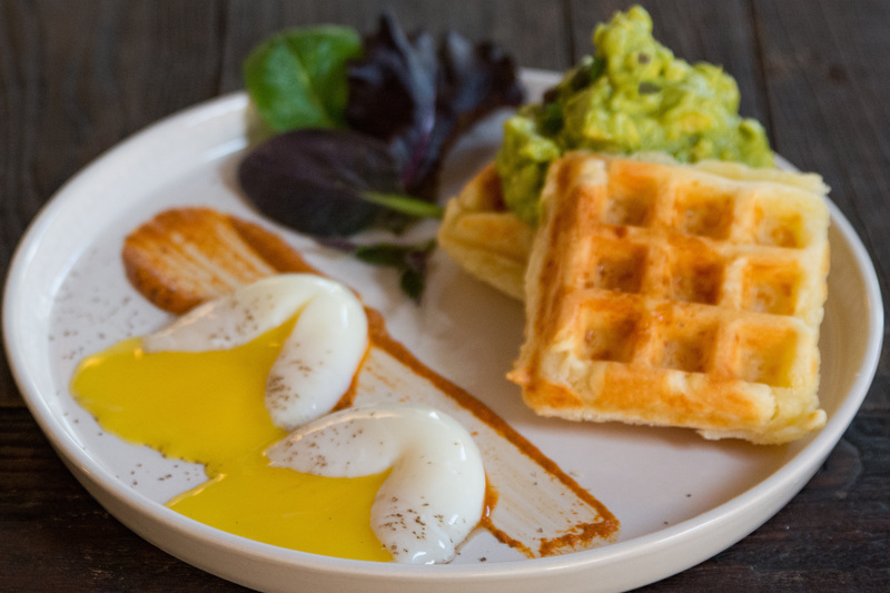 BRAZILIAN WAFFLE    Raw cheddar, egg, cassava flour, salt, butter, with two eggs sous vide and avocado mash