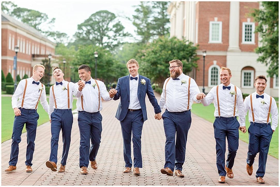 I always cue the guys to walk and while doing so they can pick on the groom, tell jokes, etc…and these guys decided to hold hands hahah! Never a dull moment with the groomsmen!