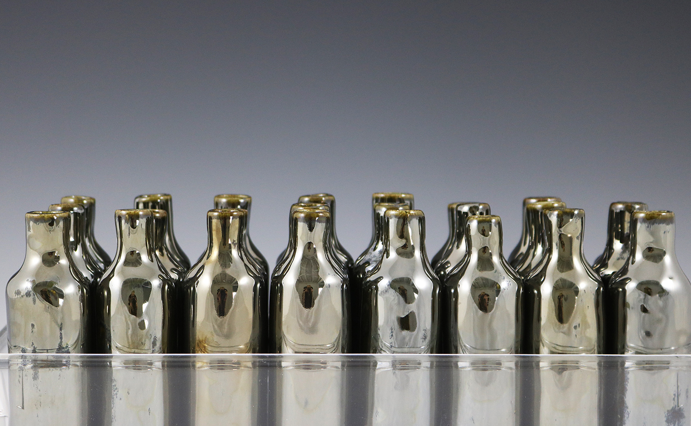16 Bottles Detail.jpg