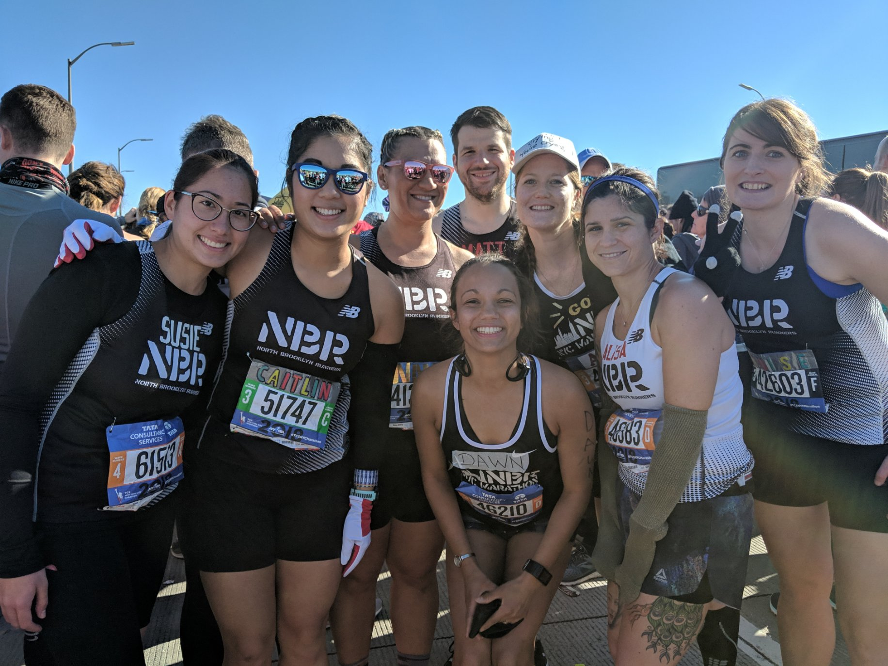 Smiling with an NBR crew before the NYC Marathon