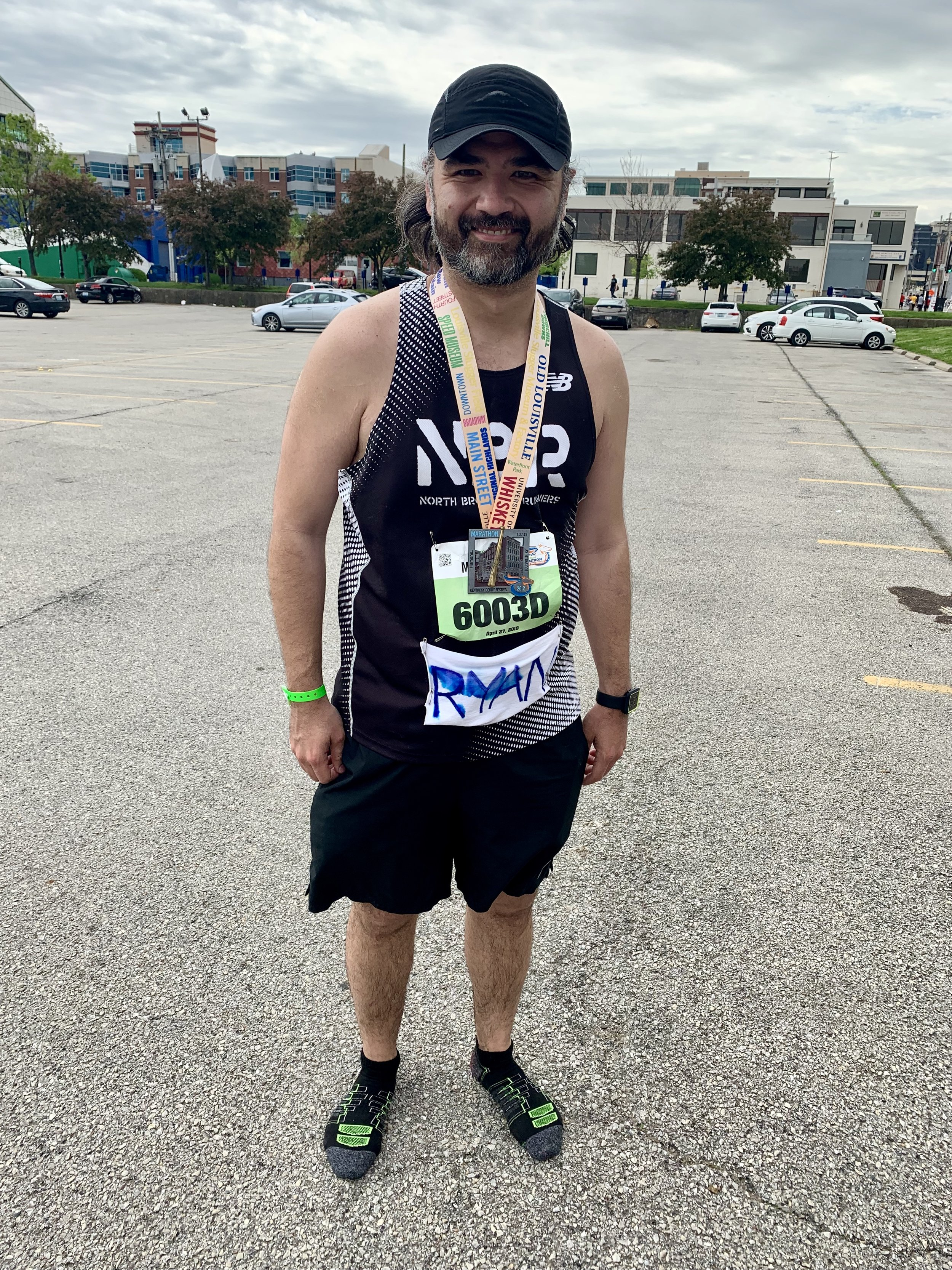 "Pattie at the finish of his first marathon: Kentucky Derby Festival in April. ""My wife made a little tag with my name on it but nobody actually yelled it, but I did have a few people yell out, Go Brooklyn!"""