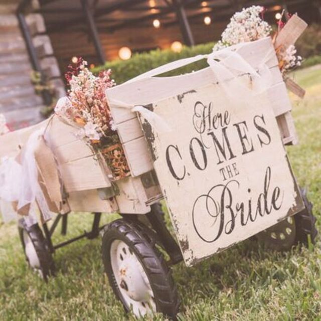 Loved this wagon used to pull the ring bearer #ringbearer #dfwweddingphotographer #weddingideas #wagon #ringbearerwagon #crosscreekranch #crosscreekranchwedding #proofphoto #dfwwedding