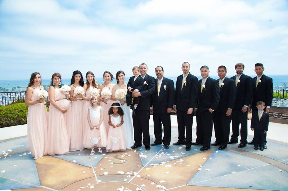 The couple's ceremony was held at Heritage Park over looking the Dana Point shore in Dana Point, California.
