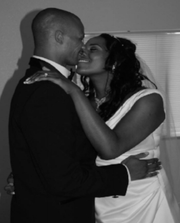 This is a photograph from my own wedding, notice the blinds and poor picture resolution. This would have never happened had I hired an experienced professional photographer.