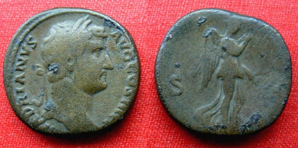 Brass sestarius of Hadrian with Nemesis on the flip side.